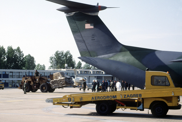 A C-141B Starlifter aircraft from the 63rd Airlift Wing is unloaded following its arrival at the Zagreb Airport to deliver 25,000 meals ready to eat (MREs) as part of a humanitarian airlift to refugees displaced by war