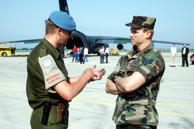 STAFF SGT. Shawn Clark from the 4th Mobile Aerial Port Squadron converses with a Norwegian member of the United Nations peacekeeping force at Zagreb Airport during a humanitarian relief project to help the refugees of the war-torn area