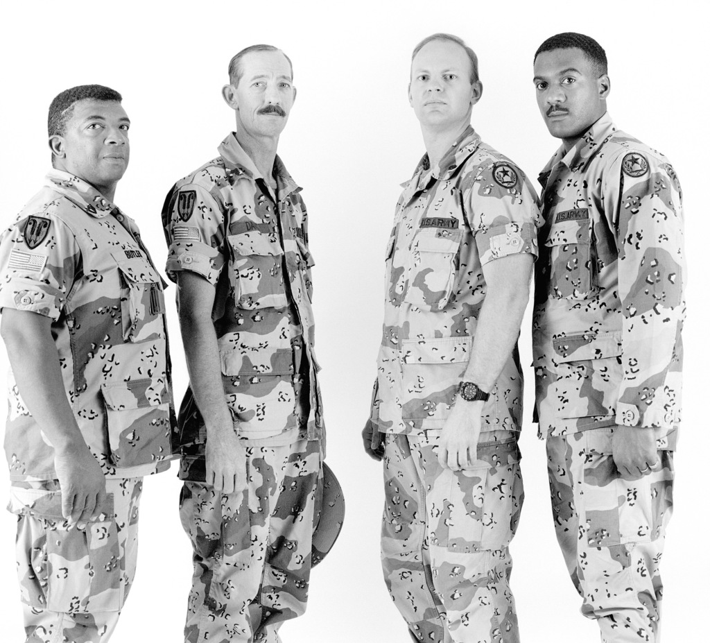 A group portrait of the soldiers of the 1104th Movement Detachment prior to the unit's demobilization. The detachment is a reserve unit that was called to active duty during Operation DESERT SHIELD. The soldiers are, from left: Sergeant First Class (SFC) Tommy Butler, Sergeant (SGT) Donald Davis, Lieutenant Dana Manuel and SGT Roy Wright