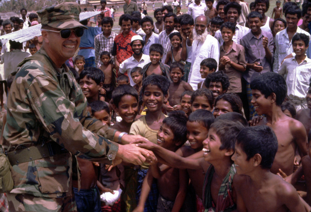 Children greet LT. COL. Paul Gido as he and fellow members of the 5th Marine Expeditionary Brigade arrive in the region as part of Operation Sea Angel, a U.S. military effort to aid victims of a cycloned which struck the area on April 30th
