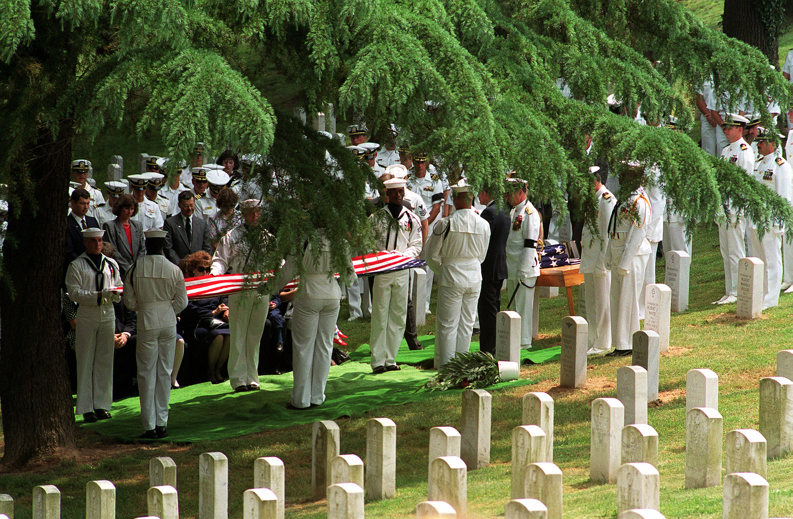 Members of the Navy Ceremonial Guard fold the flag to be presented to the widow of LT. CMDR. Barry T. Cooke of Attack Squadron 36 (VA-36) during a memorial service at Arlington National Cemetery. Cooke and his bombardier/navigator, LT. Patrick K. Connor, were killed when their A-6E Intruder aircraft was shot down on February 2, 1991, during Operation Desert Storm