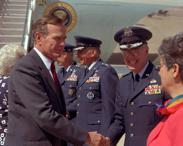 LT. GEN. Thomas S. Moorman Jr., commander-in-chief, Air Force Space Command, and Mrs. Moorman greet President George Bush upon his arrival on base en route to the Air Force Academy graduation. GEN. Donald J. Kutyna, commander-in-chief, North American Air Defense Command/U.S. commander-in-chief, Space Command, greets Mrs. Bush in the background