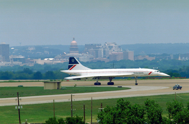 A British Airways Concorde supersonic transport aircraft taxis to a stop upon arrival on base. The plane is carrying England's Queen Elizabeth II and her husband, Prince Philip, Duke of Edinburgh, who are arriving for a royal visit