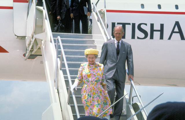 England's Queen Elizabeth II and her husbaand, Prince Philip, Duke of Edinburgh, disembark from a British Airways Concorde supersonic transport aircraft upon their arrival for a royal visit
