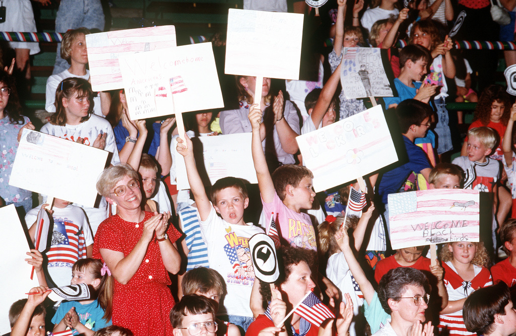 Children and their parents welcome members of the 8th Special Operations Squadron to Stewardson-Strasburg School. The servicemen corresponded with the children while stationed in the Persian Gulf area during Operations Desert Shield/Desert Storm. Now that they have returned from deployment, the men have traveled to Illinois to meet and spend a day with their pen pals