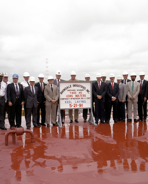Officials of Avondale Industries, Inc., Shipyards Division, and Navy representatives gather for a group photograph at the keel-laying of the surveying ship USNS WATERS (T-AGS-45)
