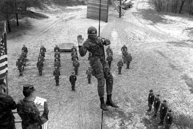 CPT Ron Desauza, a military policeman, re-enlists while suspended from a rappelling rope during an air assault course