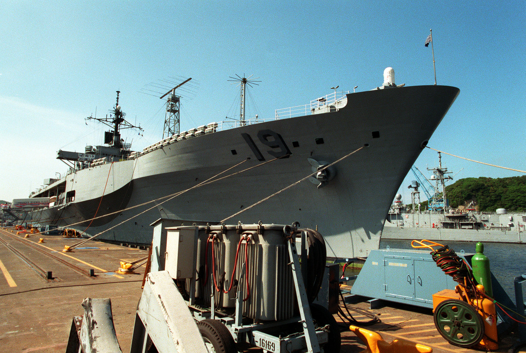 A starboard bow view of the amphibious command ship USS BLUE RIDGE (LCC-19) docked at a pier following its return to home port. The BLUE RIDGE has just returned from deployment in the Persian Gulf during Operations Desert Shield/Desert Storm