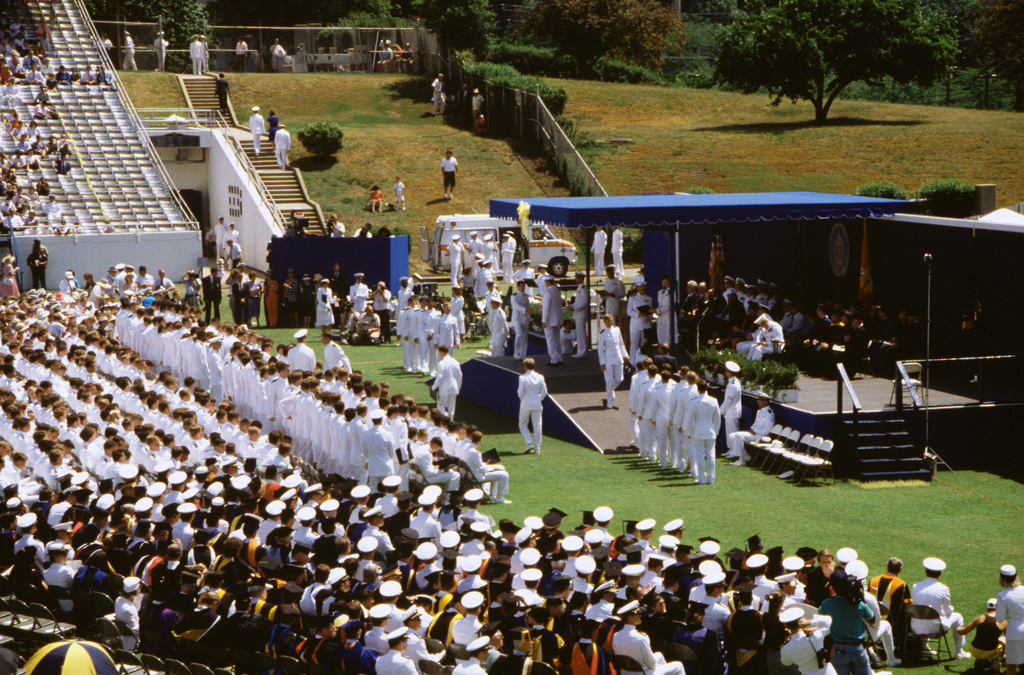 Members of the Naval Academy's Class of 1991 line up at the base of the platform to receive their diplomas during the academy's graduation and commissioning ceremony. Nearly 20,000 guests attended the ceremony, during which 937 midshipmen were graduated