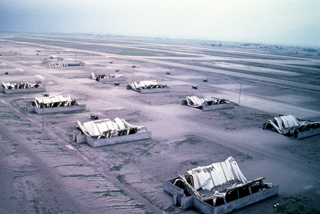 Aircraft weather shelters are collapsed after more than four inches of volcanic ash fell as a result of the June 10 eruption of Mount Pinatubo. More than 20,000 evacuees have been removed from the area as a part of the U.S. military's Operation Fiery Vigil.