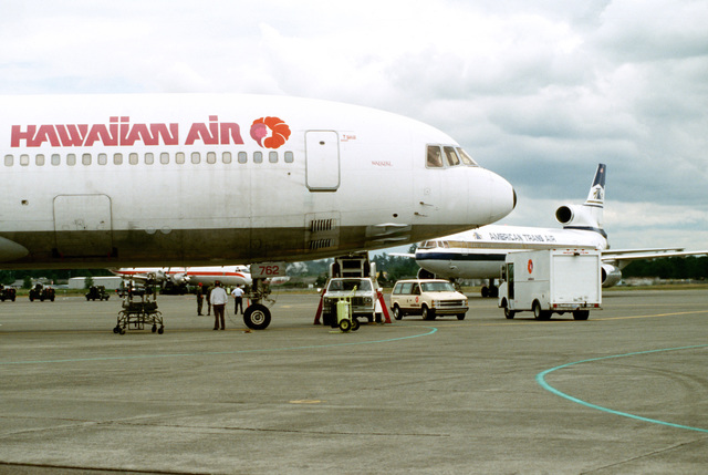 Civilian aircraft crowd the flight line after transporting hundreds of U.S. Air Force and Army personnel, civilian employees and their dependents from the Philippines during Operation Fiery Vigil. Military bases in the Philippines are being evacuated after fallen ash from the druption of Mount Pinatubo collapsed buildings and disrupted base operations.