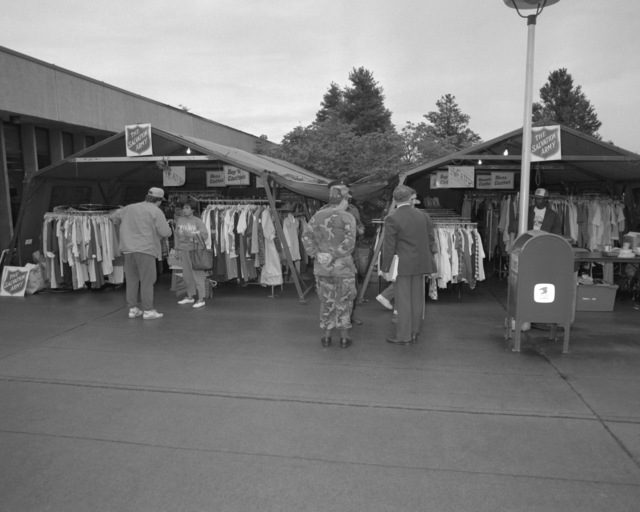 Clothing provided by the Salvation Army is displayed for evacuees arriving from the Philippines. Civilian and military personnel and their dependents were evacuated from Clark Air Base and Naval Station, Subic Bay, in the aftermath of Mount Pinatubo's volcanic eruption on June 10th. Exact Date Shot Unknown