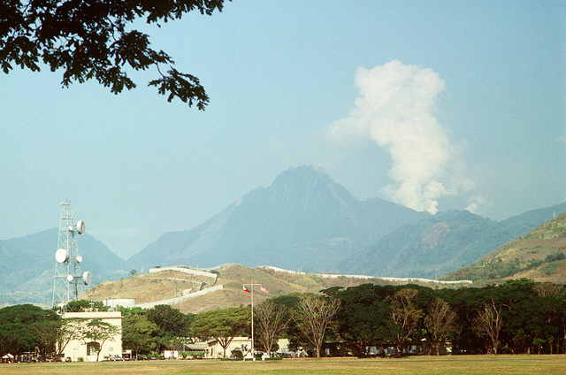 Clouds of ash pour from Mount Pinatubo as the volcano comes alive for the first time in over 600 years. Mount Pinatubo is forcing the U.S. military to conduct Operation Fiery Vigil evacuation efforts to remove over 20,000 evacuees from Clark Air Base, foreground, and Naval Station, Subic Bay