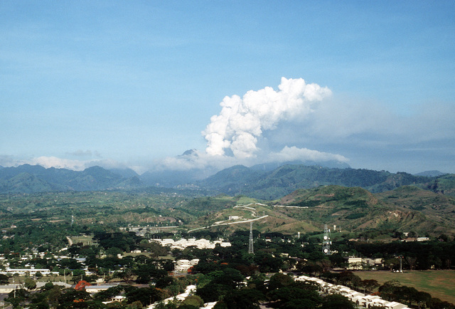 Clouds of ash pour from Mount Pinatubo as the volcano comes to life for the first time in over 600 years. Mount Pinatubo is forcing the U.S. military to conduct Operation Fiery Vigil evacuation efforts during which over 20,000 evacuees will be removed from Clark Air Base, foreground, and Naval Station, Subic Bay