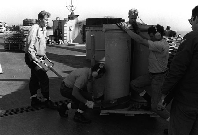 Crewmen position a Mark 4 propellant canister on a pallet on the deck of the battleship USS MISSOURI (BB-63). Ammunition is being offloaded after the ship's return from the Persian Gulf following the cease-fire that ended Operation Desert Storm