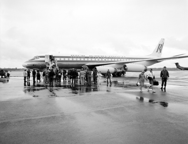 Evacuees from Clark Air Base and Naval Station, Subic Bay, disembark from a commercial aircraft following their arrival on base. Civilian and military personnel and dependents are being evacuated from the Philippine bases in the aftermath of Mount Pinatubo's volcanic eruption on June 10th