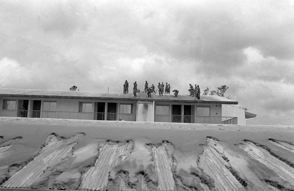 Marines shovel ash from the roof of base quarters in the aftermath of the eruption of Mount Pinatubo, a volcano that came alive on June 10th for the first time in over 600 years