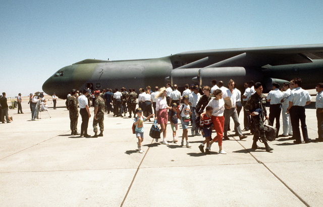 Military personnel prepare to board a C-141B Starlifter aircraft after dependents debark following an evacuation flight from the Philippines. Over 20,000 evacuees were removed from the area during Operation Fiery Vigil in the aftermath of Mount Pinatubo's eruption. The volcano erupted for the first time in over 600 years, causing disruption of operations at both Clark Air Force Base and Naval Station, Subic Bay