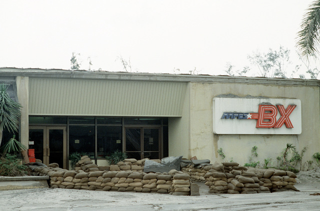 Sand bags protect the entrance of the base exchange as a precaution against possible flooding on the base in the aftermath of the eruption of Mount Pinatubo