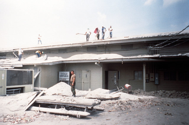 The roof of the Cubi Point chapel is collapsed from the weight of four inches of volcanic ash that fell following the June 10 eruption of Mount Pinatubo. More than 20,000 evacuees have been removed from the area as a part of the U.S. military's Operation Fiery Vigil