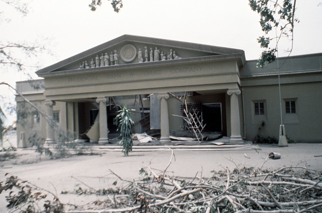 The roof of the Prudential Bank and Trust Company is collapsed under the weight of the four inches of volcanic ash that fell as a result of the June 10 eruption of Mount Pinatubo. More than 20,000 evacuees have been removed from the area as a part of the U.S. military's Operation Fiery Vigil