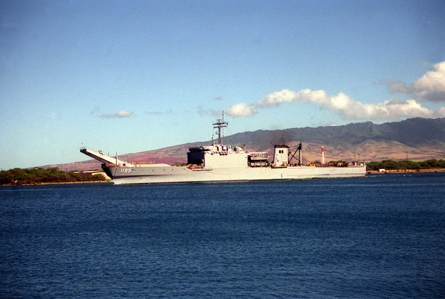 The tank landing ship USS BARBOUR COUNTY (LST-1195) departs Naval Station, Pearl Harbor, to return to Naval Station, San Diego, Calif., following its deployment to the Persian Gulf region for Operation Desert Shield and Operation Desert Storm.