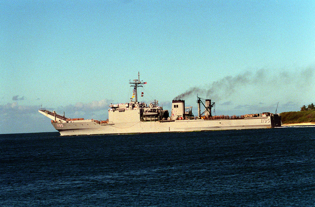 The tank landing ship USS BARBOUR COUNTY (LST-1195) heads out to sea as it departs Naval Station, Pearl Harbor, to return to Naval Station, San Diego, Calif., following its deployment to the Persian Gulf region for Operation Desert Shield and Operation Desert Storm.