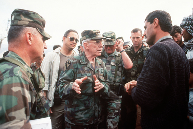 General John R. Galvin, Supreme Allied Commander, Europe (SACEUR), greets Kurdish displaced citizens, during Operation Provide Comfort at the Yekmal Camp