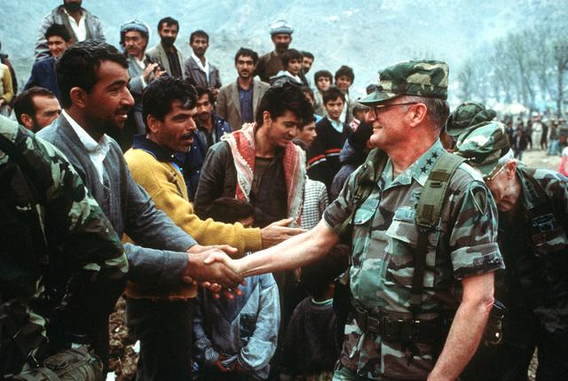 Lieutenant General John M. Shalikashvili, Commander Joint Task Force, greets Kurdish citizens at Isikveren during Operation Provide Comfort