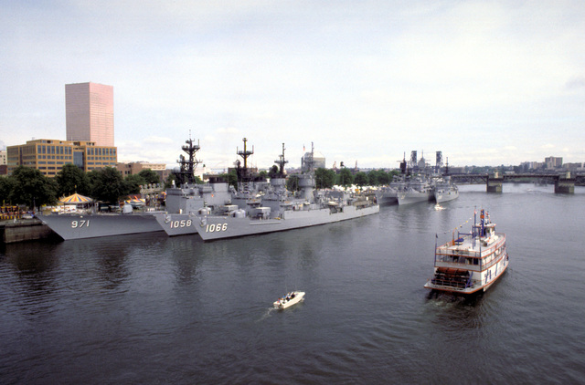 Pacific Fleet ships tied up at a dock during Portland's annual Rose Festival include, left, back to front, the destroyer USS DAVID R. RAY (DD-971), the frigates USS MEYERKORD (FF-1058) and USS MARVIN SHIELDS (FF-1066); right, back to front, the guided missile destroyers USS SEMMES (DDG-18) and USS PARSONS (DDG-33) and the frigate USS BARBEY (FF-1088)