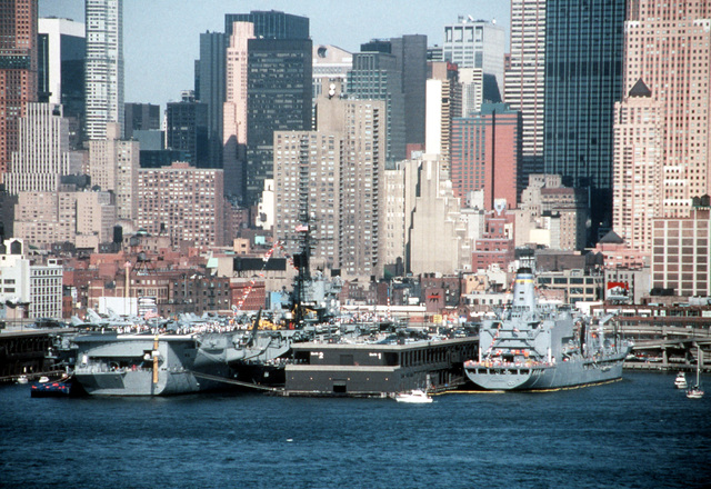 U.S. Navy ships, including the aircraft carrier USS AMERICA (CV-66), are docked at a pier during the fourth annual Fleet Week activities