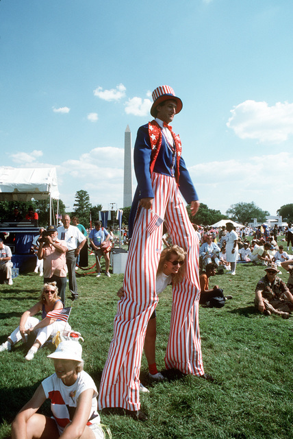 "An ""Uncle Sam"" character walking on stilts near the Washington Monument during the National Victory Celebration honoring the coalition forces of Desert Storm"