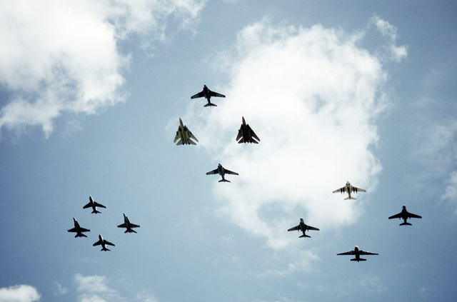 Various aircraft take part in a flyover during the National Victory Celebration which is being held in honor of Allied forces' liberation of Kuwait during Operation Desert Storm. The aircraft include A-7 Corsair II and F/A-18 Hornet aircraft in the left formation, F-14A Tomcat and A-6E Intruder aircraft in the center formation and A-6E Intruder and S-3A Viking aircraft in the right formation