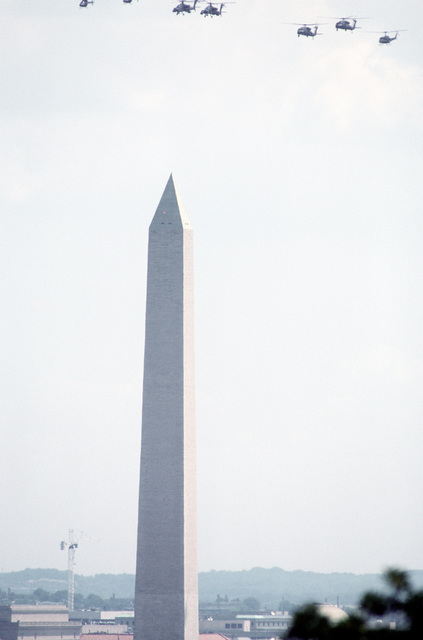Varius helicopters fly over the Washington Monument during the National Victory Celebration which is being held in honor of the Allied forces' liberation of Kuwait during Operation Desert Storm. The helicopters include, two AH-64 Apaches, two UH-60 Black Hawks and a UH-1 Iroquois helicopter