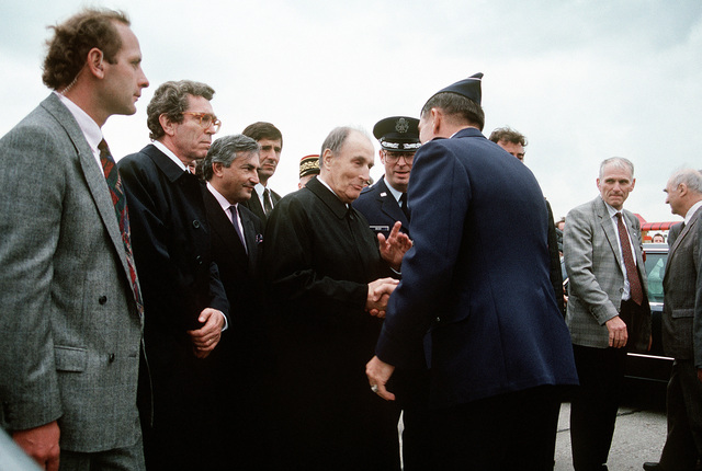 A U.S. Air Force general greets French President Francois Mitterrand as the president arrives for a tour of the American displays at the 1991 Paris Air Show