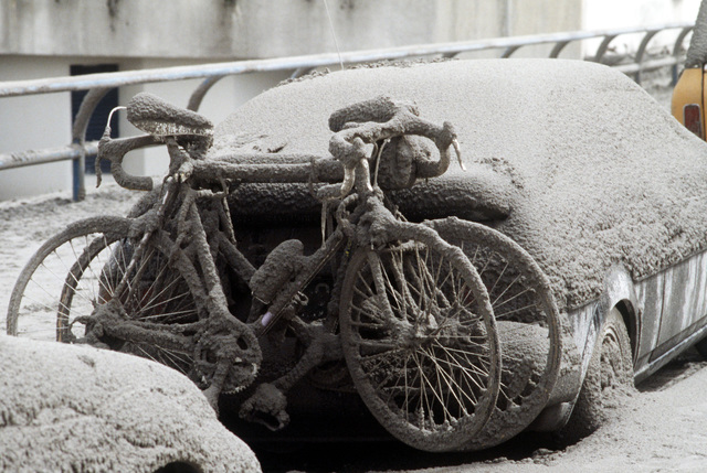 Ash blankets an automobile and the two bicycles hanging on its bumper following the eruption of Mount Pinatubo. Four inches of volcanic ash fell on the area as a result of the eruption