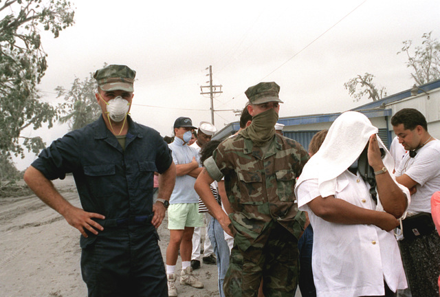 Military personnel wear masks as protection against inhaling ash during cleanup efforts in the aftermath of Mount Pinatubo's eruption. The volcano, which came alive for the first time in over 600 years, erupted on June 10th.