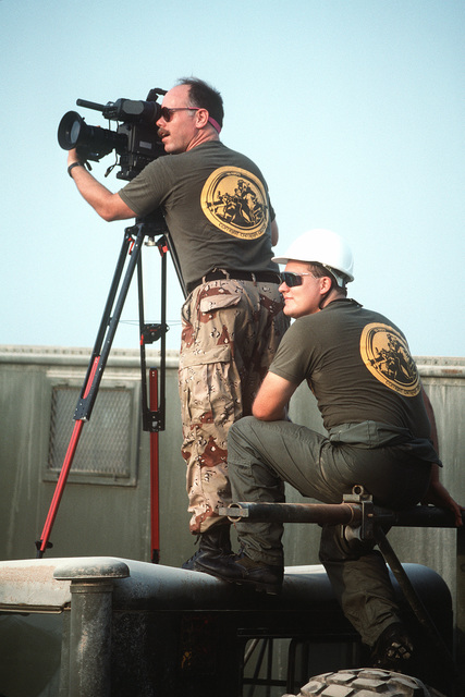 A video cameraman with the Combat Camera Group films redeployment operations in the aftermath of Operation Desert Storm