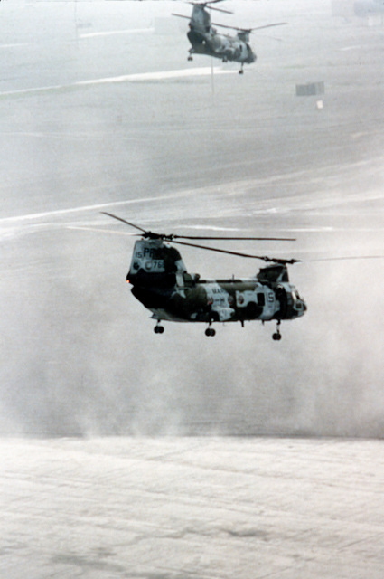 Marine Medium Helicopter Squadron 364 (HMM-364) CH-46E Sea Knight helicopters combat swirling ash as they attempt to land on base in the aftermath of Mount Pinatubo's eruption. The volcano, which erupted for the first time in over 600 years, forced the U.S. military to coordinate Operation Fiery Vigil evacuation efforts to remove more than 20,000 evacuees from the area
