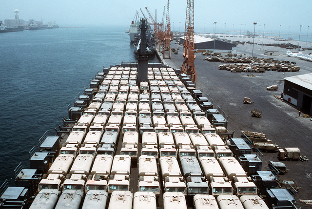 Oshkosh M-977 heavy expanded mobility tactical trucks are parked on the deck of a Military Sealift Command vehicle cargo ship for redeployment to the United States in the aftermath of Operation Desert Storm