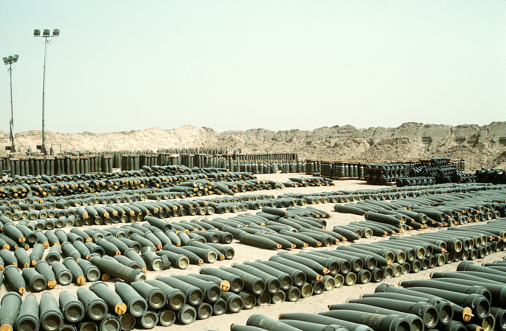 Rows of 155mm howitzer projectiles line a holding area at Ammo Supply Point 3 near Mishab. The ordnance is being stored in preparation for shipment back to the United States in the aftermath of Operation Desert Storm
