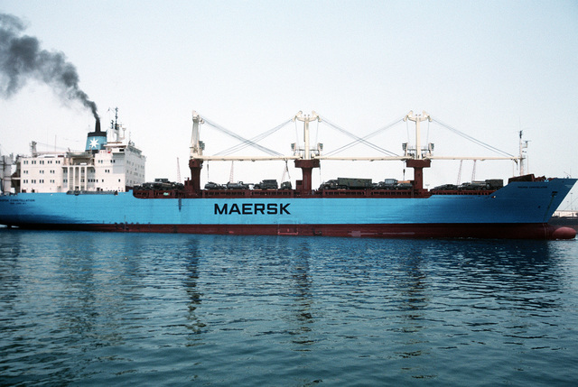 The Military Sealift Command-chartered vessel Maersk Constellation rides high in the water as it prepares to depart from port. The ship is transporting vehicles and equipment for redeployment to the United States in the aftermath of Operation Desert Storm