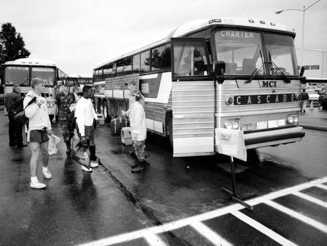 Chartered buses stand ready to transport civilians and military personnel to a nearby airport for the final stage of their journey following their evacuation from the Philippines. The evacuees were transported from Subic Bay Naval Station and Clark Air Base following the eruption of Mount Pinatubo, a volcano that came alive on June 10 for the first time in over 600 years. More than 20,000 evacuees have been removed from the area as part of the U.S. military's Operation Fiery Vigil