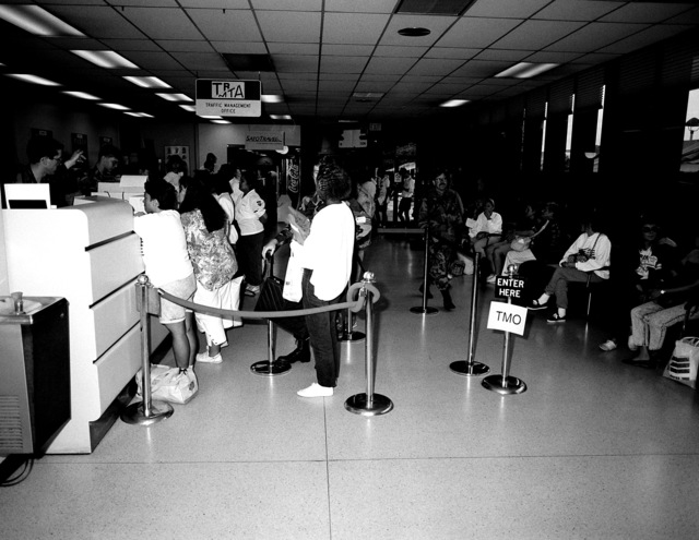 Evacuees stand in line to receive their tickets for commercial airlines during the final stage of their journey from the Philippines. The evacuees have been transported from Subic Bay Naval Station and Clark Air Base following the eruption of Mount Pinatubo, a volcano that came alive on June 10 for the first time in over 600 years. More than 20,000 evacuees have been removed from the area as part of the U.S. military's Operation Fiery Vigil
