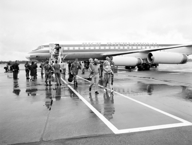 Military and civilian evacuees from the Philippines disembark from a Boeing 737 aircraft. The evacuees have been transported from Subic Bay Naval Station and Clark Air Base following the eruption of Mount Pinatubo, a volcano that came alive on June 10 for the first time in over 600 years. More than 20,000 evacuees have been removed from the area as part of the U.S. military's Operation Fiery Vigil