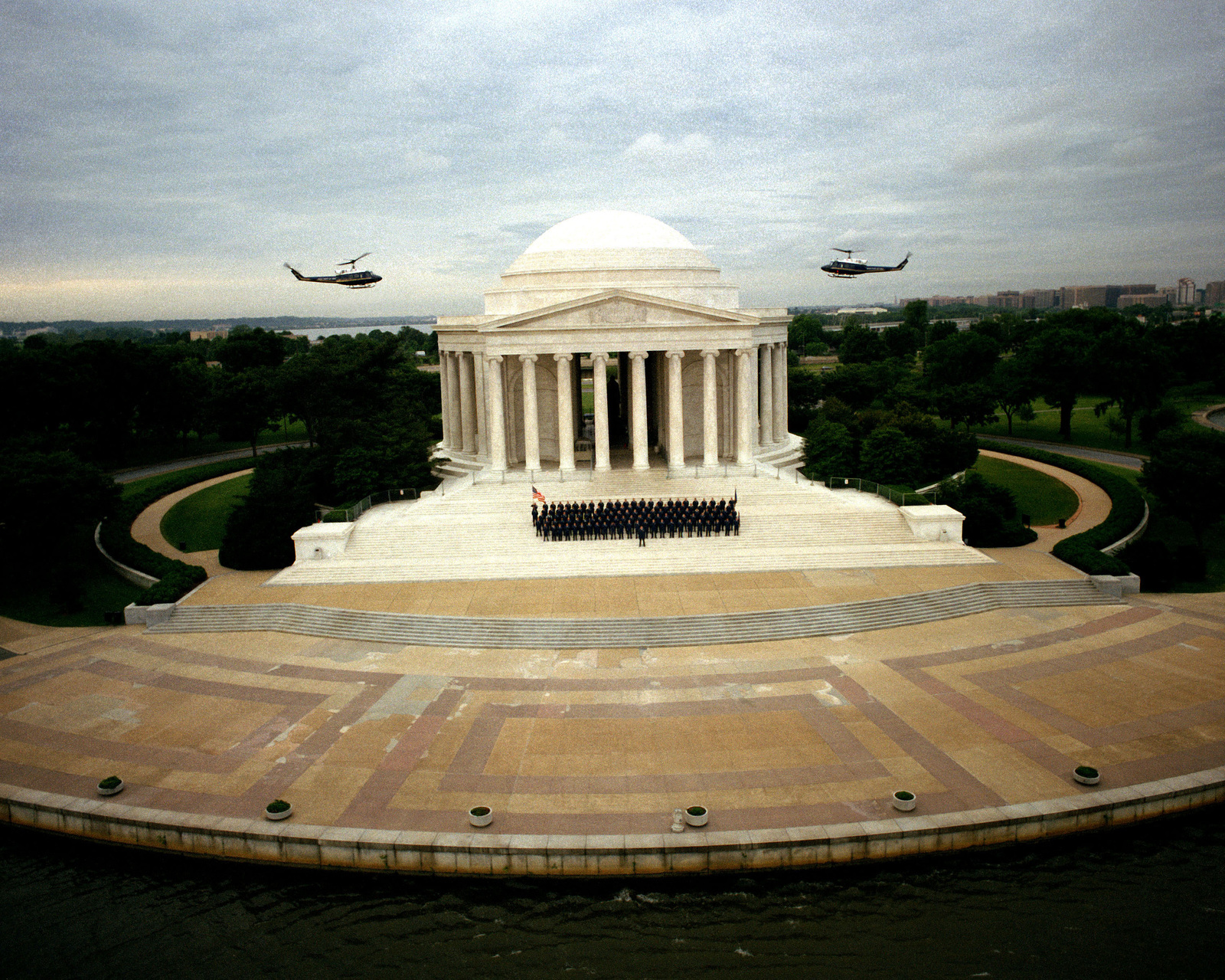 UH-1N Iroquois helicopters from the 1ST Helicopter Squadron hover above the Jefferson Memorial as members of the squadron gather on the monument's steps to celebrate their record of 150,000 accident free flight hours
