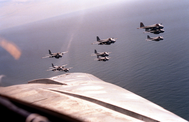 An air-to-air view of nine A-6E Intruder aircraft from Attack Squadron 36 (VA-36) flying toward the Virginia coastline as the squadrons of Carrier Air Wing 8 (CVW-8) return to their home bases after a deployment aboard the nuclear-powered aircraft carrier USS THEODORE ROOSEVELT (CVN-71). During that deployment, CVW-8 and the ROOSEVELT took part in Operations Desert Shield, Desert Storm and Provide Comfort.