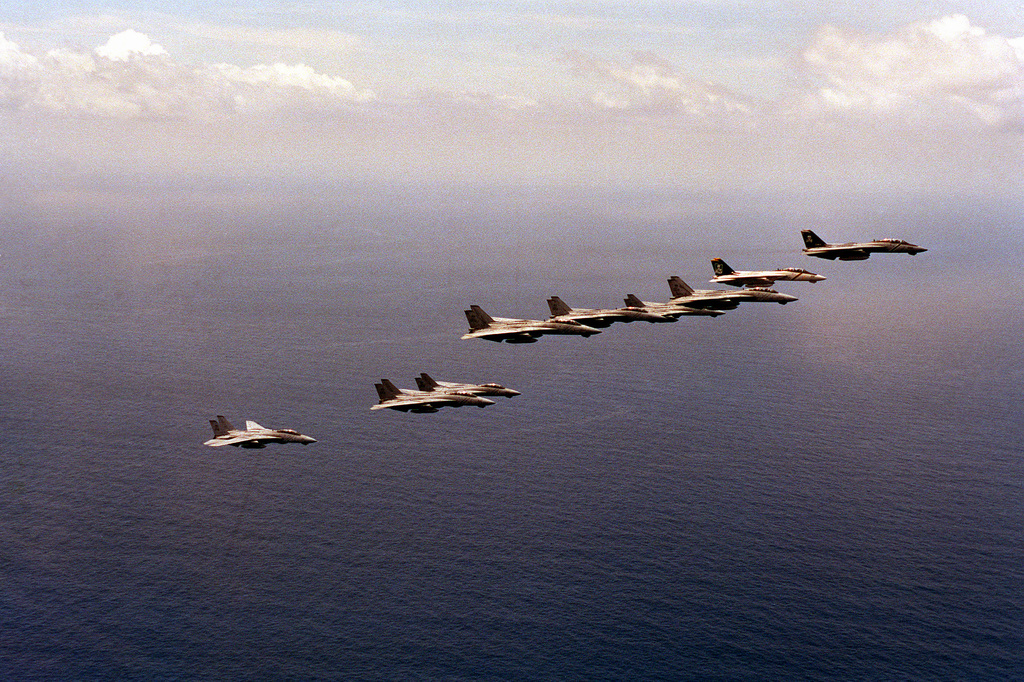 Nine F-14A Tomcat aircraft from Fighter Squadron 84 (VF-84) fly in formation near the Virginia coastline as the squadrons of Carrier Air Wing 8 (CVW-8) return to their home bases after a deployment aboard the nuclear-powered aircraft carrier USS THEODORE ROOSEVELT (CVN-71). During that deployment, CVW-8 and the ROOSEVELT took part in Operations Desert Shield, Desert Storm and Provide Comfort.