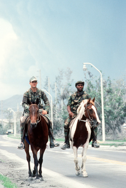 Personnel of the 3rd Security Police Group horse patrol make their rounds in the aftermath of the volcanic eruption of Mount Pinatubo. More than 20,000 evacuees have been removed from the area as a part of the U.S. military's Operation Fiery Vigil when more than four inches of fallen ash disrupted operations at Clark and Naval Station, Subic Bay