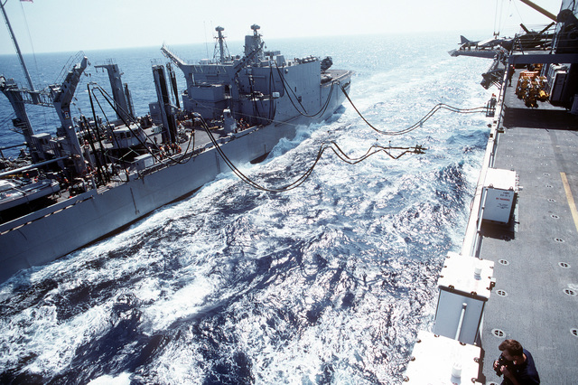 A second pair of fuel hoses is sent over to the amphibious assault ship USS WASP (LHD-1) by the replenishment oiler USS MILWAUKEE (AOR-2) as the ships conduct an underway replenishment during the WASP's first deployment